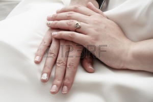 29808074-bride-hands-folded-in-her-lap